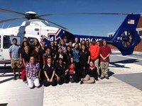 Students and teachers in front of a helicopter