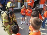 Students and a firefighter