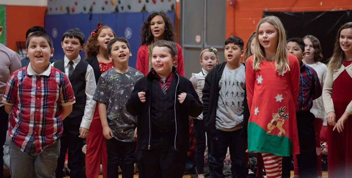 Elementary School students singing in a Christmas Play