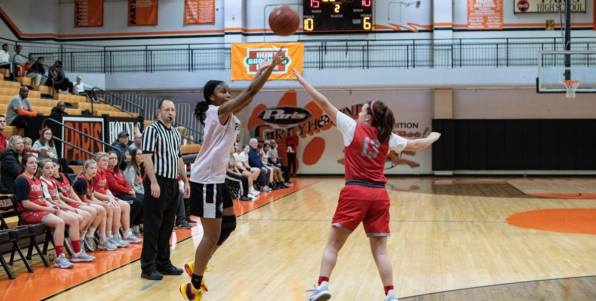 Girls Basketball player shooting 3 point shot