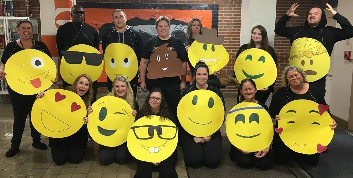Middle School Teachers in Emoji Halloween costumes